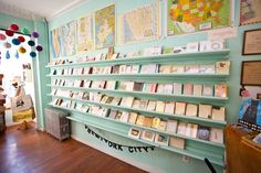 Best stationery stores in New York City: pretty wall color, shelves, prints surrounding