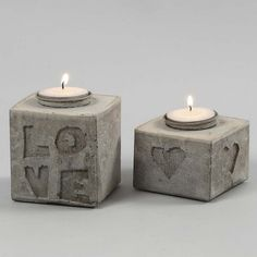 Cast Candle Holders with Letters & Shapes in Relief. Time; 30 mins. + 24hrs drying time. using a Tetra Carton, craft concrete, self adhesive foam letters/shapes, candle holder.