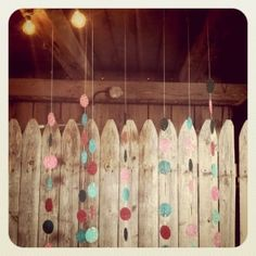 DIY photo booth background on fence by shawn
