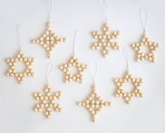 Set of 4 Christmas decorations tree ornaments woven blonde wood bead modern scandinavian minimalist holiday xmas decor stars snowflake - Set of 4 Wood Bead Christmas Tree Decorations **Buy 2 sets and the second set ships for free** Thes - Diy Christmas Star, White Christmas Ornaments, Handmade Christmas, Christmas Holidays, Beach Christmas, Holiday Tree, Christmas Toys, Simple Christmas, Beaded Christmas Decorations