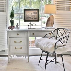 This Vintage Thomasville white faux bamboo desk has recently been painted a lovely high-gloss white. Perfect for winter!