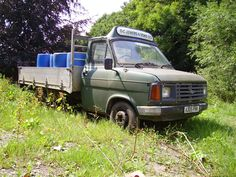 A ford transit MK2 dropside pickup truck with what's probably it's last ever load on board. What a great colour. It looks like it's still saveable.