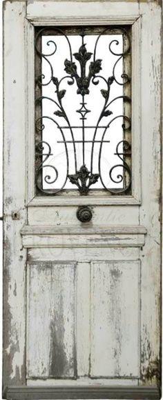 white door with iron decoration