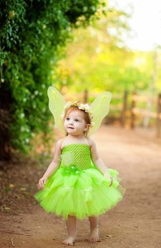 This adorable Tinker Bell dress is just what your little girl needs to jump into the world of Peter Pan. She will feel just like a fairy while wearing this bright green dress with wings!