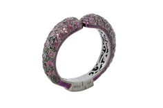 Louise Bangle from The Manhattan Collection: hand made 925 sterling silver plated with black rhodium, hand-set with rhodolite garnet and black spinel accented by glittering purple enamel.