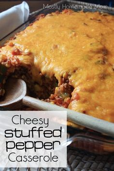 Cheesy Stuffed Pepper Casserole - green peppers, cheese, tomatoes, rice... comfort at it's finest!! www.mostlyhomemademom.com