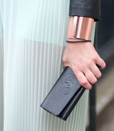 Chanel and gold cuff