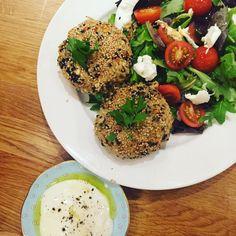 Aubergine veggie burgers coated in sesame seeds and served with yogurt dip. So filling but light and healthy