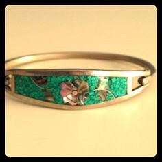 Turquoise Floral Bracelet Gorgeous piece from Mexico. Turquoise inlay with pearl like flowers. Silver, will not tarnish. Clip clasp. Better for small wrists Jewelry Bracelets
