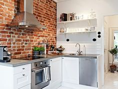 brick wall kitchen 39 m2 po Skandynawsku - kawalerka
