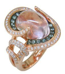 Nice ring with a kunzite stone, diamonds and green sapphire.