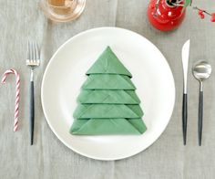 Christmas Tree Napkin Fold.  Now this would be so clever...if only I weren't immersed in my traditional raging frenzy on Christmas Day.  Maybe next year.