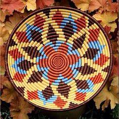 Africa | Rwanda basket.  Naturally dyed sisal coil-sewn over bundled sweetgrass
