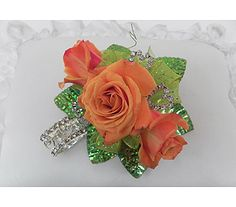 """Mango"" Orange roses with green lazer leaves, green wire, glittery ribbon, rhinestone hearts and a keepsake heart rhinestone bracelet!"