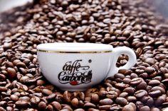 Coffee cup in coffee beans. the coffee's horizon. Caffe Carbonelli  #coffee  #espresso #caffè