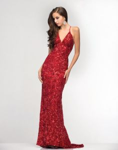 Scala 47515 We love love LOVE backless dresses! This Scala gown is fully sequined, with a v neckline and criss cross spaghetti straps. The red is in stock at Ypsilon, and we just received it in a teal color too!! Come pick your favorite!!