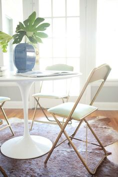 Why don't you....spray paint some folding chairs gold and add white fabric to the seats? An easy way to glamorize the mundane.