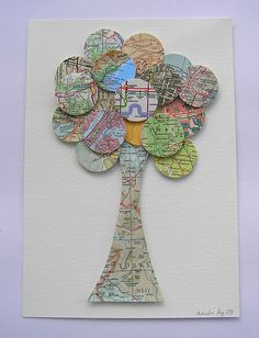 handmade greeting card ... upcycled map paper ... tree with lots of circles punched from maps ... luv the look with all the same sized circles and each one with its own predominate color ... great use for out of date maps ...