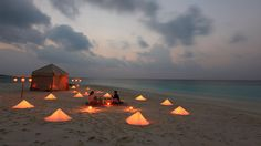 Baa Atoll, Maldives - Like a page out of Robinson Crusoe, this no-shoes-required, remote island in the Maldives is filled with intrigue, discovery and tropical excitement. Castaways can picnic for dinner on the sandbank in front of their villa, lit only by tiki torches, stars and the amber glow of coruscating tents.