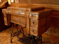White treadle sewing machine cabinet