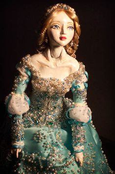 """Cinderella""    The artist, Marina Bychkova, considers this  doll to be an extremely significant piece in her artistic development because Cinderella is the symbol of her creative identity and the Mother of all ""The Enchanted Dolls""."