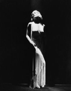 American film actress Carole Lombard shows off the lines of her dress and her figure