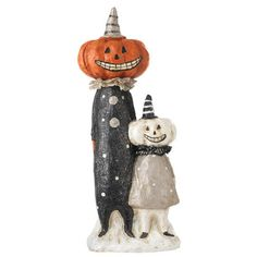 """RAZ Jack O'Lantern People Figurine  Black, White, Orange Made of Calcium Carbonate Measures 17.5"""" X 6.5"""" X 3.5""""  Whimsical Halloween characters with pumpkin heads and silly grins."""