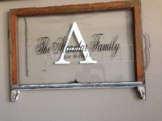 Family name and established (wedding) date on an old window