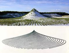 Agnes Denes. A huge manmade mountain measuring 420 meters long, 270 meters wide, 38 meters high and elliptical in shape was planted with eleven thousand trees by eleven thousand people from all over the world at the Pinziö gravel pits near Ylöjärvi, Finland, as part of a massive earthwork and land reclamation project by environmental artist Agnes Denes.