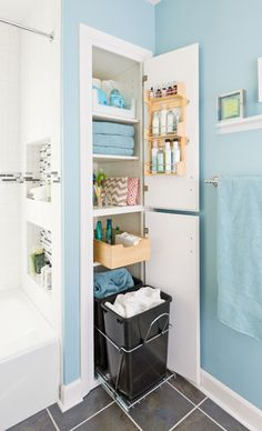 Pull out laundry hamper. Door toiletry organization.
