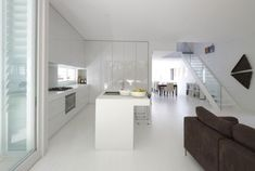 Very serene and open kitchen with a white décor and stylish accent features