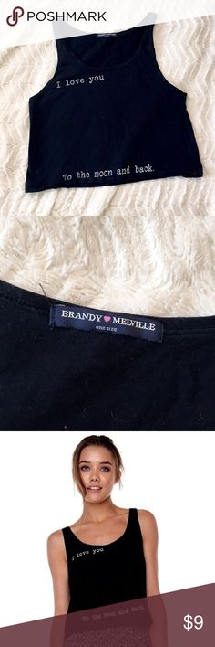 """Brandy Melville Black To-The-Moon-and-Back Tank One size • In great condition, no damage • This was my go-to shirt because it goes with *everything* • Cropped • Straps are about 3/4"""" wide • Typewriter print says """"I love you to the moon and back"""" • Make an offer! Brandy Melville Tops Crop Tops"""