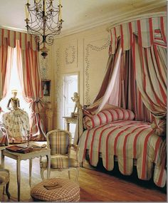 lit a la polonaise with silk fabrics next to simple painted furniture. Loved the dressed statue in the window.