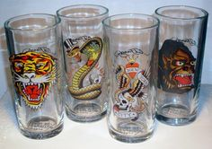 Ed Hardy Predator High Ball Glass Set of 4 14 Oz EH6805  Assorted Prints in this set include:Gorilla, New York City, Tiger, Snake. Each Ed Hardy Glass features the print on one side and the Ed Hardy Logo on the other and Don Ed Hardy Designs on the bottom.