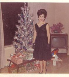 I love everything about this. The hair, the dress, the tree. Even the tv.