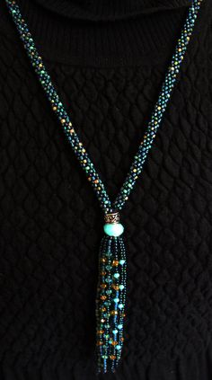 Kumihimo is a Japanese technique of braiding multiple strands of beads to create an intricate beaded rope. This necklace was hand crafted with
