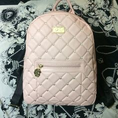 Betsey Johnson Backpack Quilted baby pink Betsey Johnson backpack. Tiny heart embroidery between quilting, zippered front pocket and logo embroidered adjustable straps. Brand new with tags. Total impulse buy, but just not really my color. Never used! Betsey Johnson Bags Backpacks