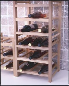 Vino, please!  The HUTTEN wine rack holds up to nine bottles and can stack three units high.