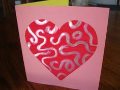 Valentine Craft.  Paint tinfoil, use qtip to draw pattern or words, make into a card.  I can do this... it is super cute.