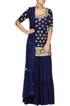 Esha Koul Featuring a dark blue short kurta in silk base with gota work all over and tie up detailing at the back. It is paired with matching gharara pants in georgette base and dupatta with scattered motifs. Indian Party Wear, Indian Wear, Pakistani Dress Design, Pakistani Dresses, Indian Attire, Indian Outfits, Style Audrey Hepburn, Gharara Pants, Gharara Designs