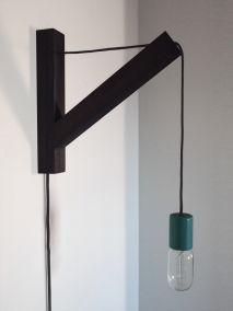 bracket light - I think I could make this with one of those cord lights from CB2...  COOL!