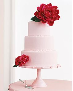 Pale pink wedding cake decorated with camellias