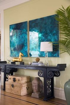 Turquoise artwork with a modern feel works beautifully with a black altar table and Asian accessories in this vignette by Sylvia Martin. Photo from Houzz.