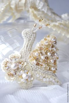 http://www.livemaster.ru/item/7337581-ukrasheniya-brosh-ulitochka-14b065?vr=1