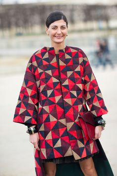 Giovanna Battaglia in Valentino, colourful geometric patterned sleevelss coat. Paris Fashion Week, Street style.