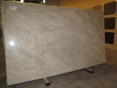 Taj mahal quartzite - May be a new fav.  Love this (color/swirls) - but is it too subtle/boring?  Or is it a good neutral choice to attract future buyers?