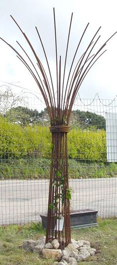 Tree umbrella out of rebar as focal point - we could string lights coming up and out like faux water feature