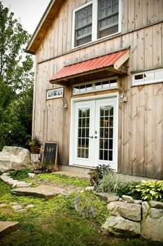 rustic. love the metal awning and wood siding