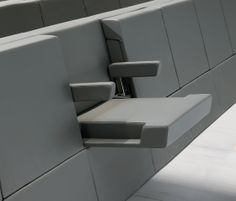 Genya armchair by Dante Bonuccelli. When closed, the seat has the appearance of a compact wall.