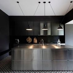 I black kitchen I stainless steel kitchen Island I black and white tiled floor Les Acrobates de Gras & edited by DCW éditions Kitchen And Bath, New Kitchen, Kitchen Dining, Kitchen Decor, Kitchen Lamps, Eclectic Kitchen, Kitchen Black, Scandinavian Kitchen, Kitchen Islands